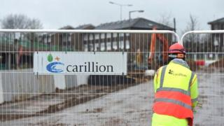 Carillion sign and worker