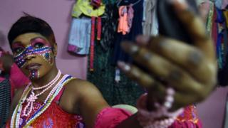 A dancer makes up ahead of a performance at the Felabration music festival in Lagos, Nigeria - Sunday 16 October 2016