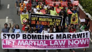 Filipino protesters march towards the Lower House to coincide with the special joint session on the possible extension of martial law in the southern Philippines, at a street in Quezon city, east of Manila, Philippines, 22 July 2017.