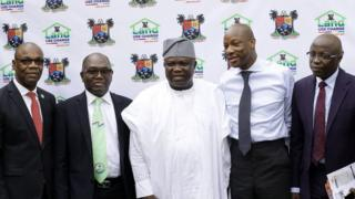 Lagos State Governor Mr. Akinwunmi Ambode (dey), with oda oga dem, Managing Director, Guaranty Trust Bank (GTB), Segun Agbaje na im wear tie stand next to di governor.