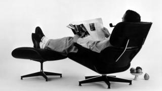 Charles Eames in the lounge chair he and his wife Ray designed