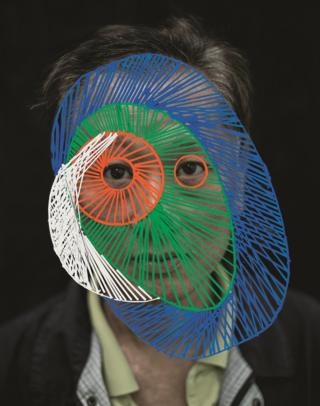 A man with circles drawn over his face.