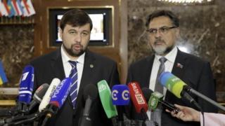 Rebel representatives Denis Pushilin and Vladislav Deinego. File photo