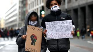Children take part in a Black Lives Matter protest in Parliament Square