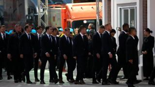 Leicester City players arrive for the funeral in Bangkok