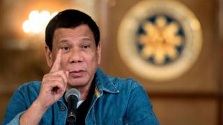 Philippine President Rodrigo Duterte gestures as he answers a question during a press conference at the Malacanang palace in Manila