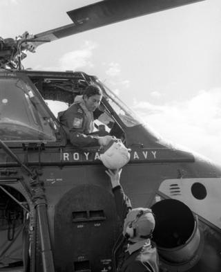 Naval Lieutenant the Prince of Wales being handed his flying helmet