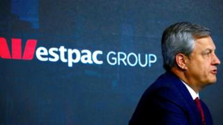 Brian Hartzer speaks to press in front of a Westpac Group sign in 2017