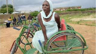 Woman wey get disability.