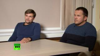 A still image taken from a video footage and released by RT international news channel on September 13, 2018, shows two Russian men with the same names, Alexander Petrov and Ruslan Boshirov, as those accused by Britain over the case of former Russian spy Sergei Skripal and his daughter Yulia, during an interview at an unidentified location