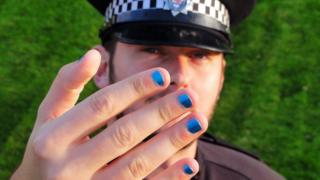 Police officer with painted nails