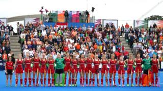The England women's hockey team line up for the national anthem in 2015