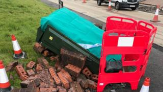 The telephone exchange box damaged by a car crash in Capel Hendre