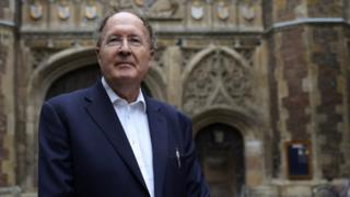 Gregory Winter, poses for photographs after being awarded the Noble Prize for Chemistry, outside Trinity College Cambridge
