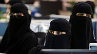Three women wearing a niqab