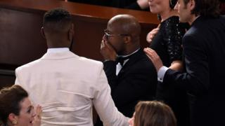 Barry Jenkins reacts as 'Moonlight' is announced as the true winner of best picture at the Oscars on Sunday, Feb. 26, 2017, at the Dolby Theatre in Los Angeles.
