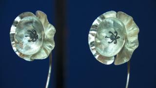 Two silver poppies