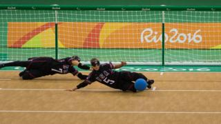 "Eliana Mason, left and Amanda Dennis, right, of the United States, work to save the ball in a Goalball women""s preliminary Group C match against Brazil during the Paralympic Games at the Future Arena, in Rio de Janiero, Brazil, Thursday, Sept. 8,"