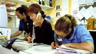 nurses at nurse station on phone