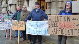 People with placards protesting outside Grimsby Town Hall