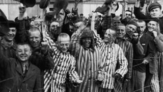 Dachau prisoners cheer soldiers who had come to free them.