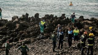 Spanish Civil Guard officials attend to dead migrants on Bastian de Costa Teguise beach, in Canary Islands, Spain on 15 January 2018.