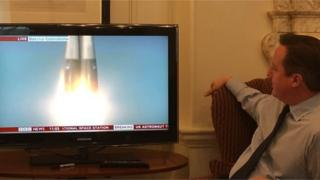 David Cameron watches launch.