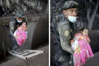 A soldier rescues a girl from a hole in an area affected by the eruption