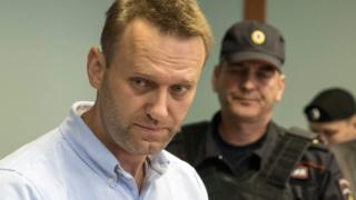 Russian jailed opposition leader Alexei Navalny arrives for a hearing at a court in Moscow, 16 June 2017