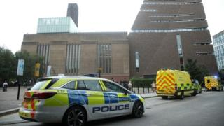 Police car and ambulances outside the Tate Modern