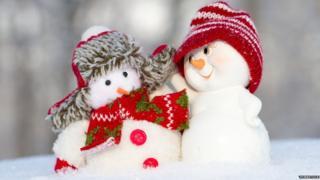 Two snowmen hugging