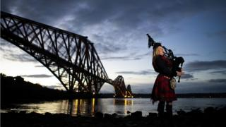 Piper Louise Marshall at dawn alongside the Forth Bridge