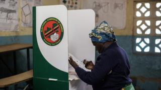 A Zambian woman looks at her ballot paper during Thursday's general election at Kanyama Basic school voting station in Lusaka.