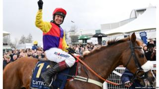Jockey Richard Johnson celebrates after winning the Timico Cheltenham Gold Cup Steeple Chase on Native River during Day Four of the Cheltenham Racing Festival