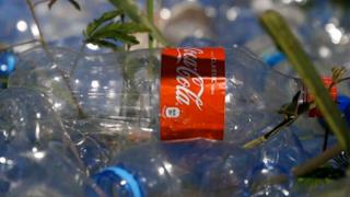 Plastic Coca-Cola bottle on the ground