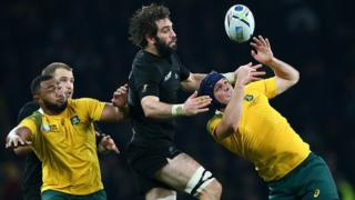Sam Whitelock of New Zealand and Dean Mumm of Australia compete for the ball during the 2015 Rugby World Cup Final