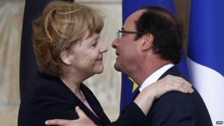 Merkel and Hollande embrace