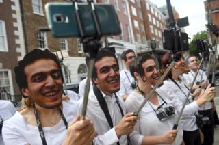 "Demonstrators take selfies outside the Egyptian Embassy to bring attention to detained photojournalist Mahmoud Abu Zeid, also known as ""Shawkan"", in central London August 14, 2017."