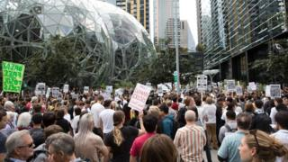 Amazon Employees for Climate Justice lead a walk out and rally at the company's headquarters