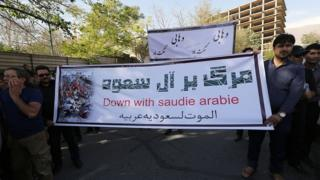 Iranian protesters hold a banner during a demonstration against Saudi Arabia outside the Saudi embassy in Tehran on 27 September 2015