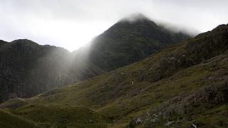Snowdon under cloud as the sun tries to push through