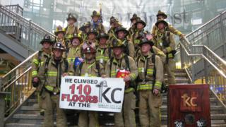 Firefighters pose at a 9/11 memorial in Kansas City, Missouri