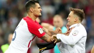 Croatia's Lovren grabbed pitch invader Pyotr Verzilov, 15 Jul 18