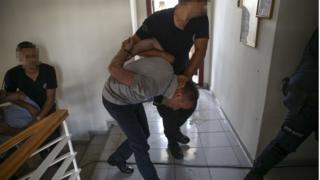 Darbe girişimi sonrası gözaltına alınan bir kişi