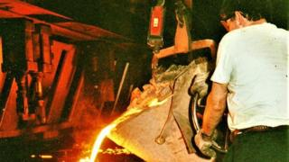 Worker inside the foundry