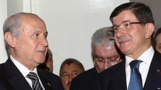 Turkey's Prime Minister Ahmet Davutoglu (right) with Nationalist Movement Party (MHP) opposition leader Devlet Bahceli (left)