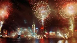 Fireworks light up the sky in Hong Kong to celebrate the province's handover to China on 1 July 1997