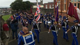 Bands taking part in the annual Apprentice Boys parade in Londonderry, bands marching around the city's historic walls, 12 August 2017
