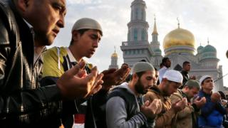 Russian Muslims attend morning prayers to celebrate Eid al-Adha (Feast of the Sacrifice) at the Moscow Sobornaya Mosque in Moscow, Russia, on 24 September 2015