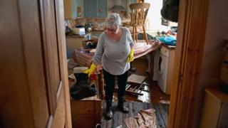 Woman inside flooded home in Carlisle